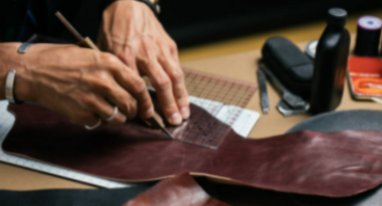 leather crafter cutting leather