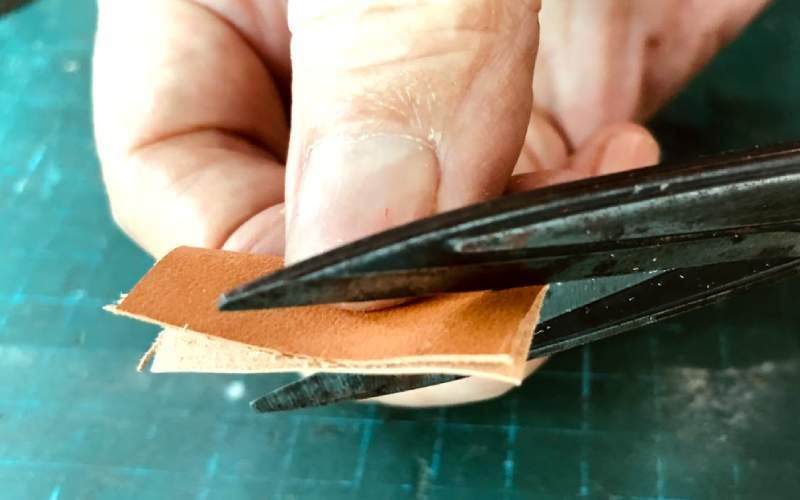cutting feather shape from leather