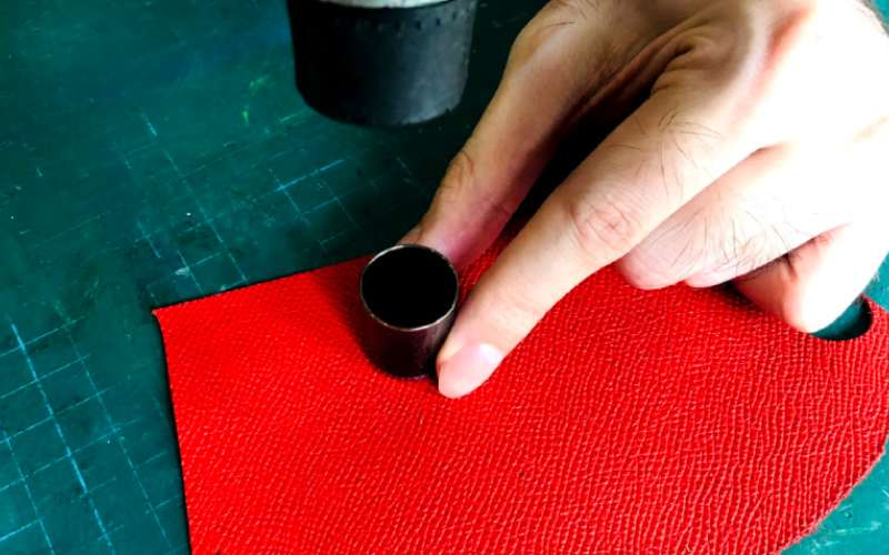 punching hole through leather for stud earrings