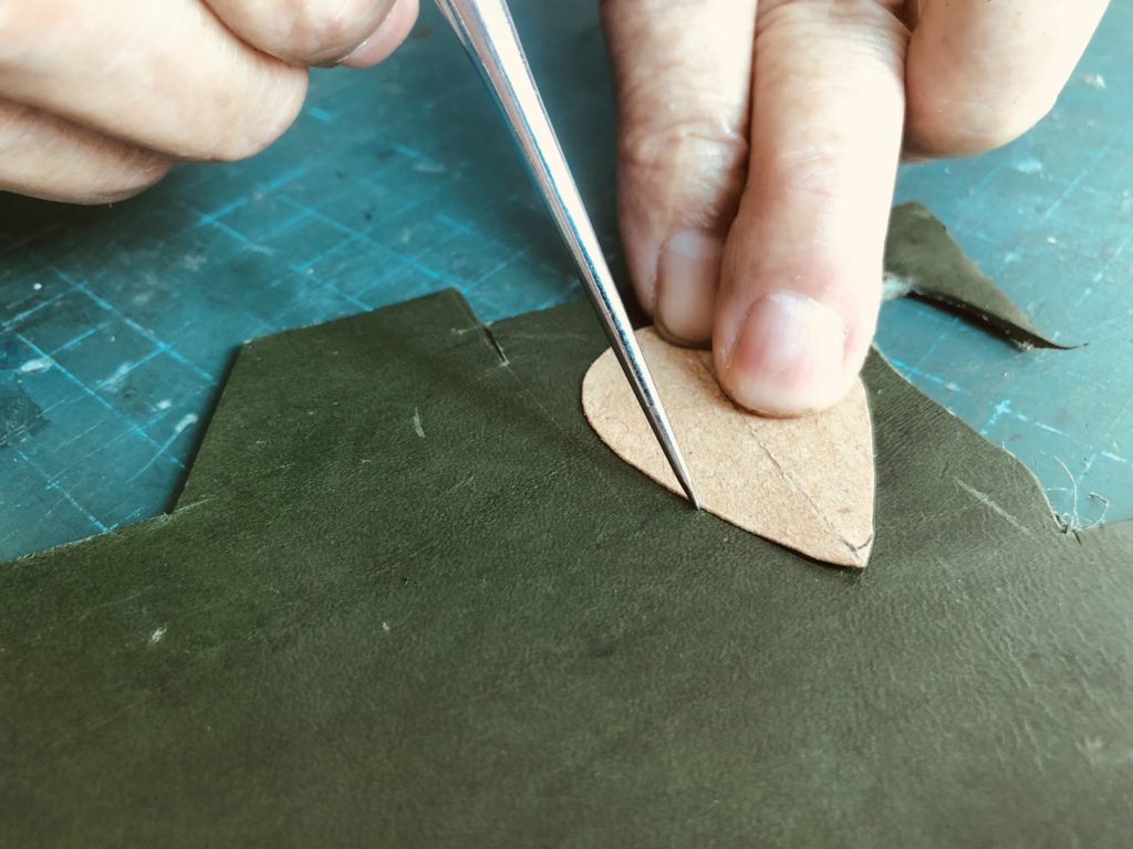 Awl to outline shape of leather tear drop