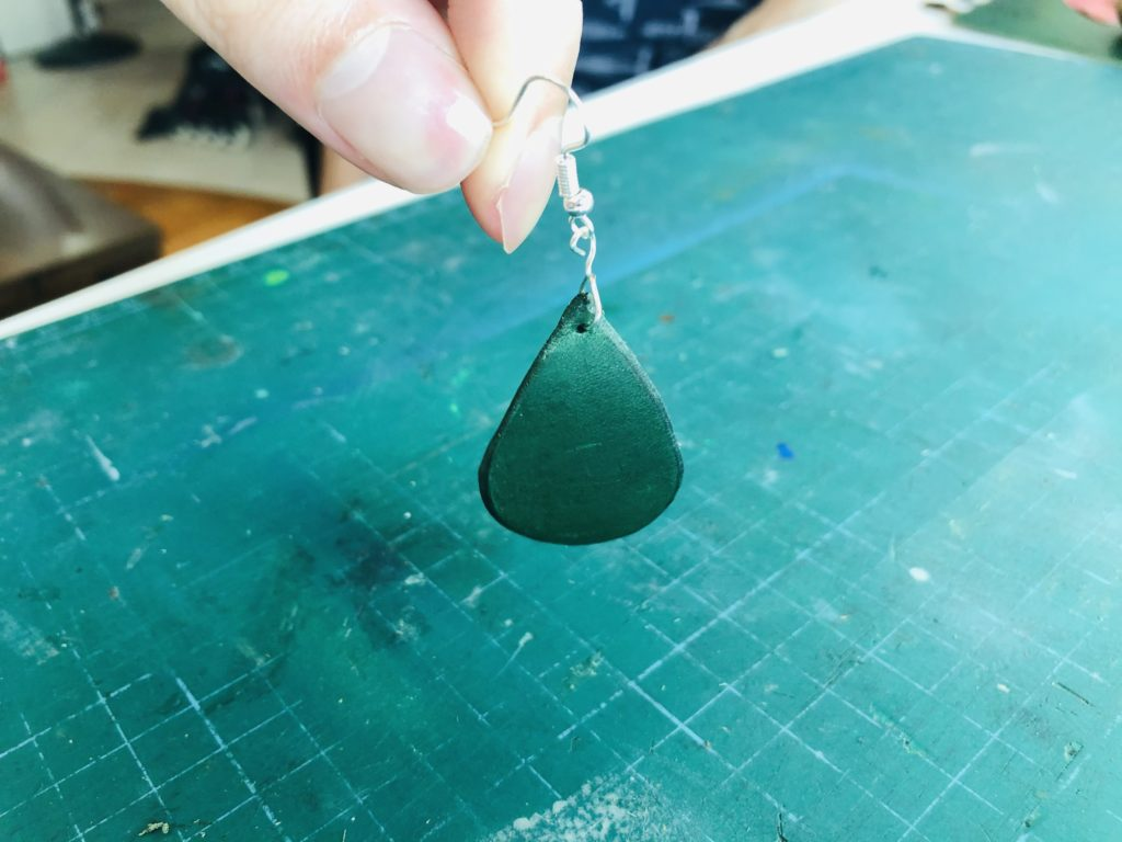 Completed leather tear drop earring